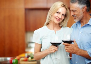 Mature Couple toasting in kitchen