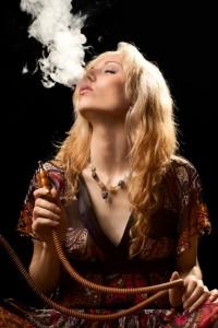 Woman smoking hookah.