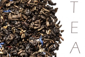 Dried Black Tea leaves isolated on a white background close up with copyspace for text.