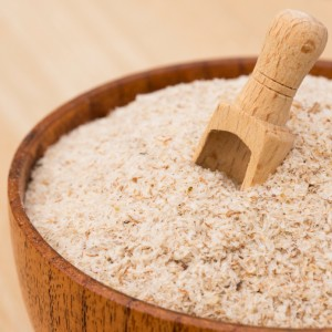 Psyllium Seeds in a bowl on wooden background