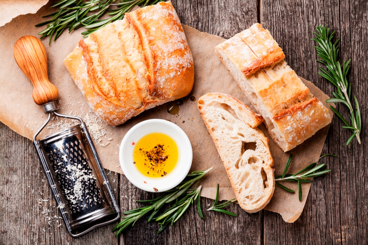 Sliced bread Ciabatta and extra virgin Olive oil on wooden background