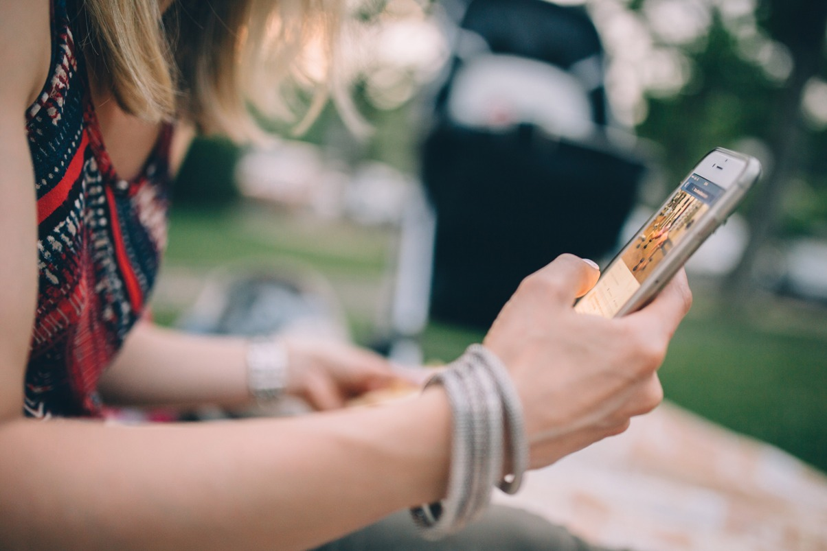 close up side view of a woman using a cell phone