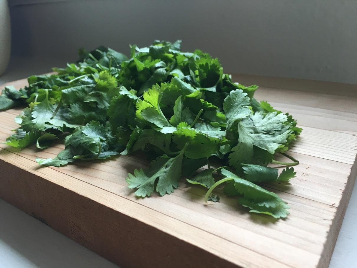 fresh cilantro on a cutting board