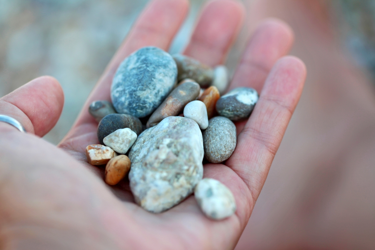 hand holding smooth stones