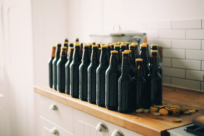 vintage soda bottles arranged on a wooden shelf