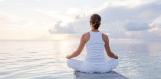 Woman meditating; yoga