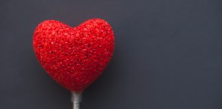 red plastic heart popsicle