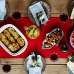 Festive table set with holiday foods