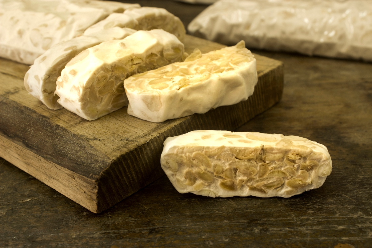 Tempeh sliced on a board