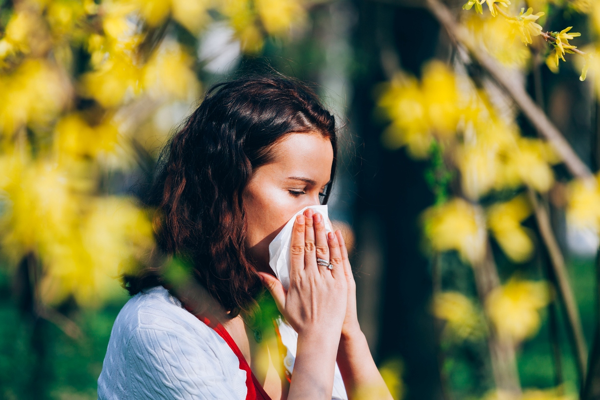 Woman Holding tissue to her nose