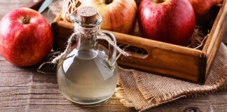 carafe of apple cider and red apples