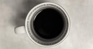 black coffee in a coffee mug; top-down image