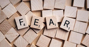 Scrabble blocks spelling out the word: FEAR