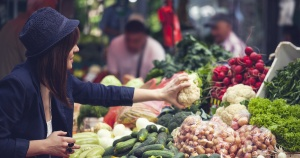 woman shopping for produce in a market