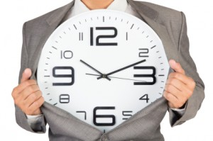 businessman showing clock in suit