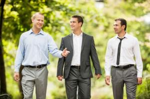 Three businessmen in the park.