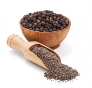 milled black pepper isolated on white background