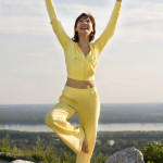 woman performing qigong exercise
