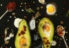 vibrant avacado and eggs with spoons of spices