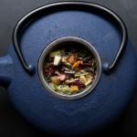 Herbs inside a blue tea kettle