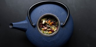 Herbs inside a blue tea kettle