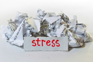 "Wadded up paper with a ""stress"" sign"