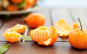 Fresh tangerines on a wooden table