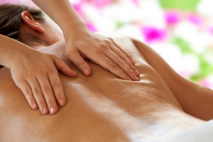 Close up of female therapist's hands doing back massage on woman.