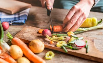 hands holding a knife; chopping vegetables