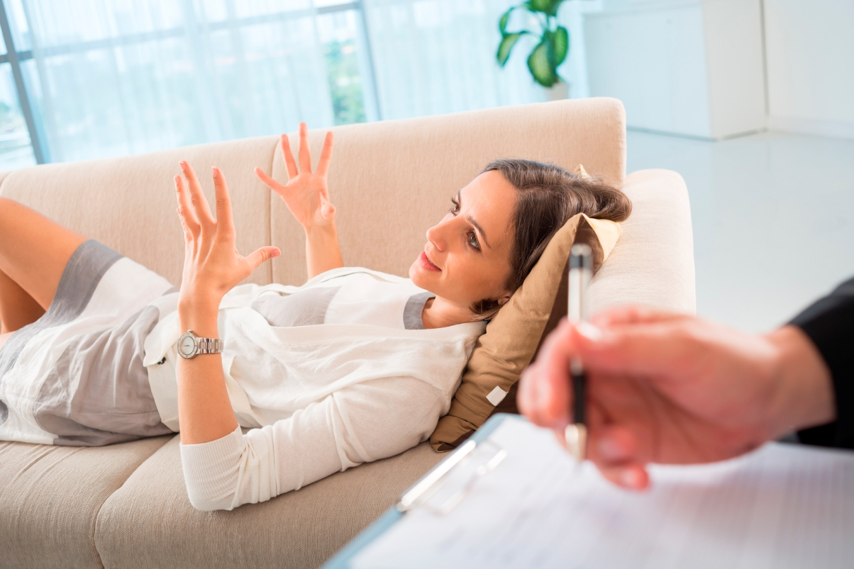 women laying on couch in therapy session