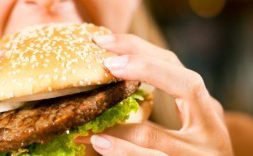 woman eating a hamburger