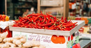 large bin of red chili peppers in a market