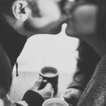 black and white man and woman kissing