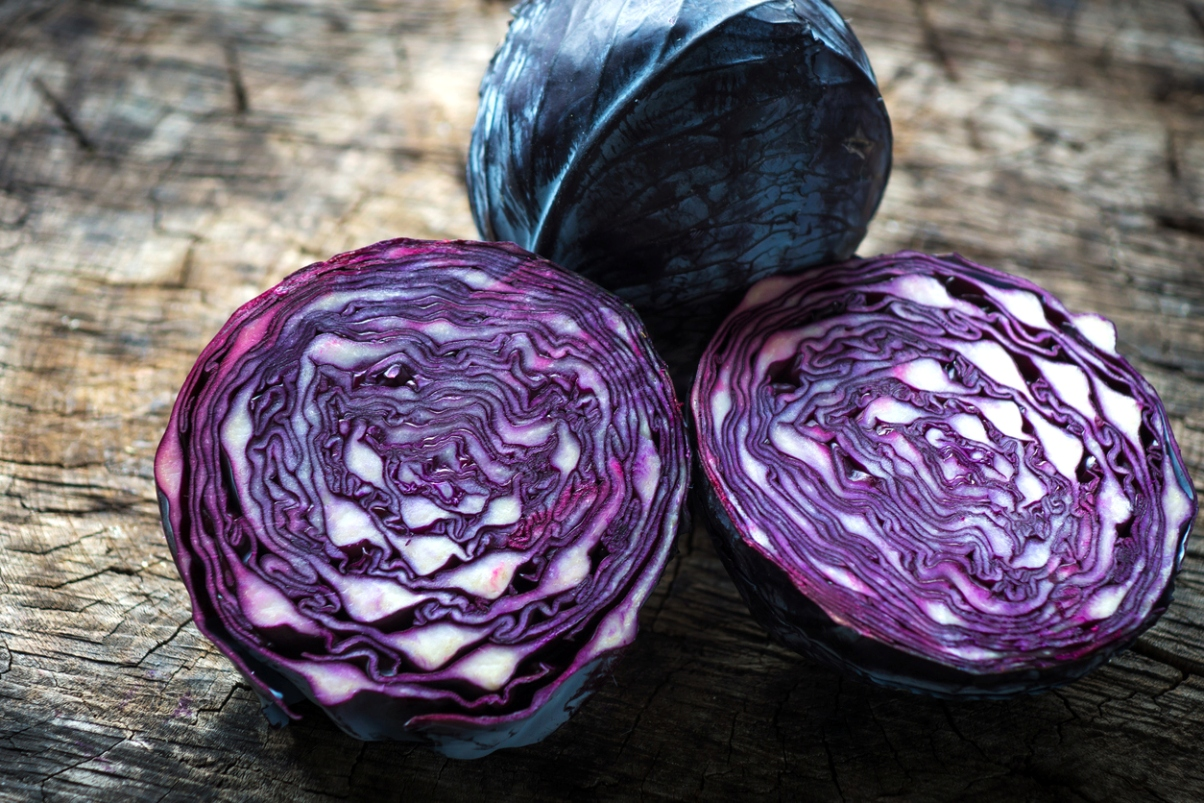 split purple cabbage on tree rings