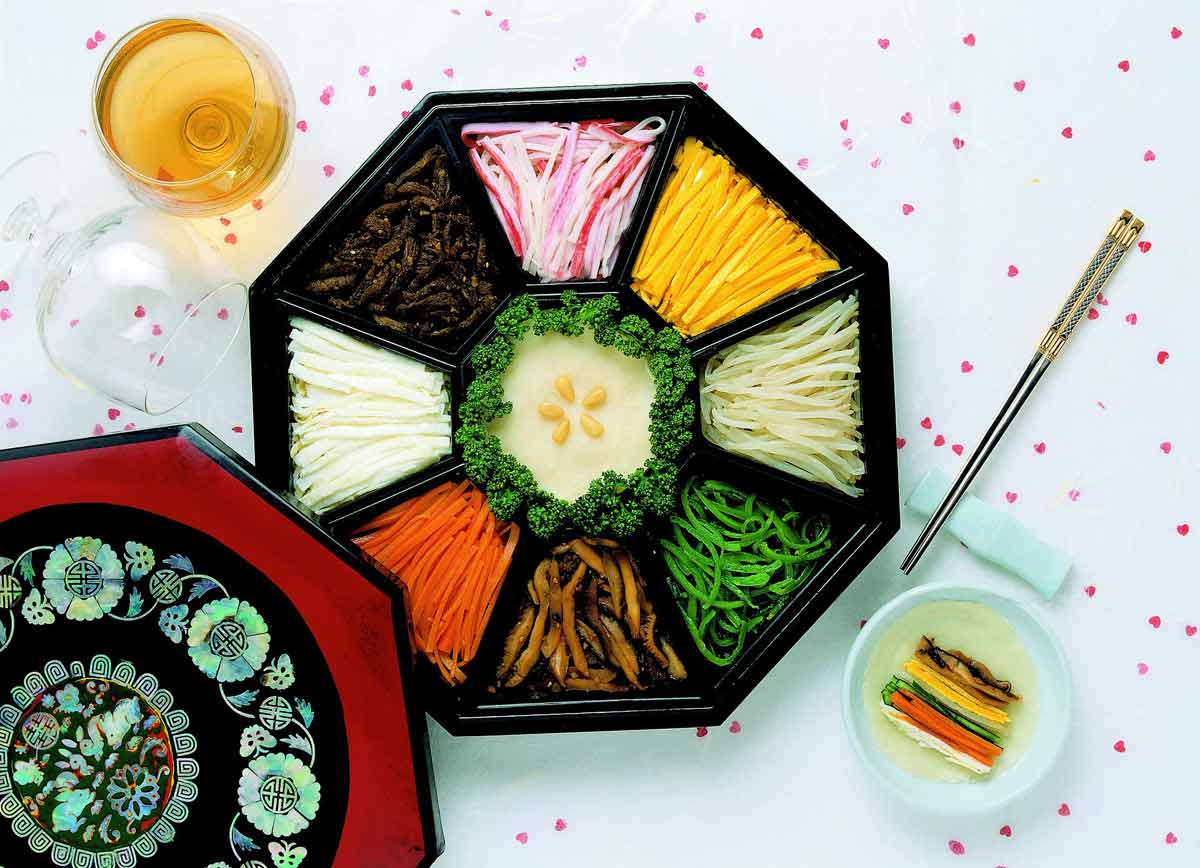 relish tray with assorted Julienned vegetables and chopsticks
