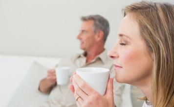 man and woman drinking tea