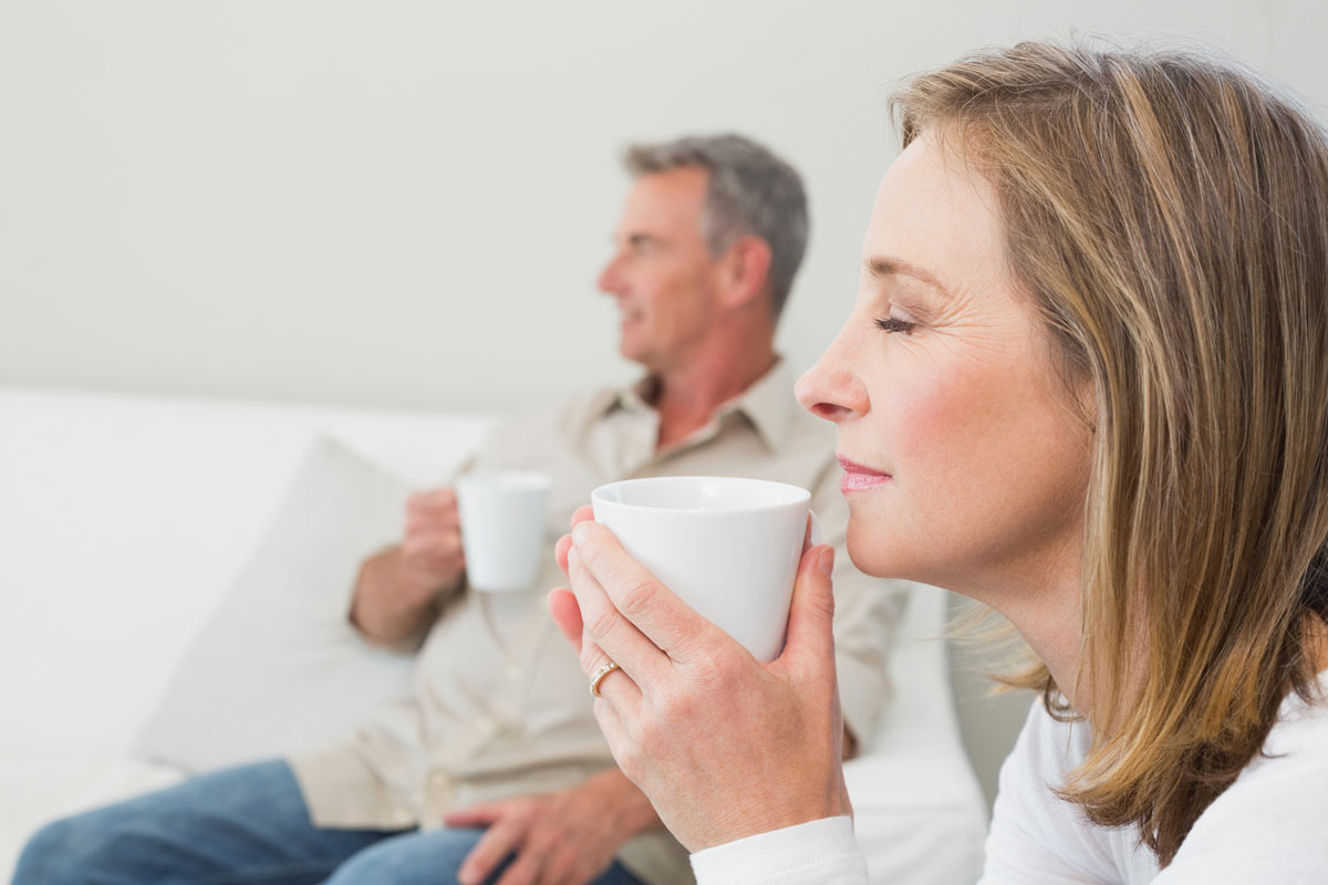 man and woman drinking tea