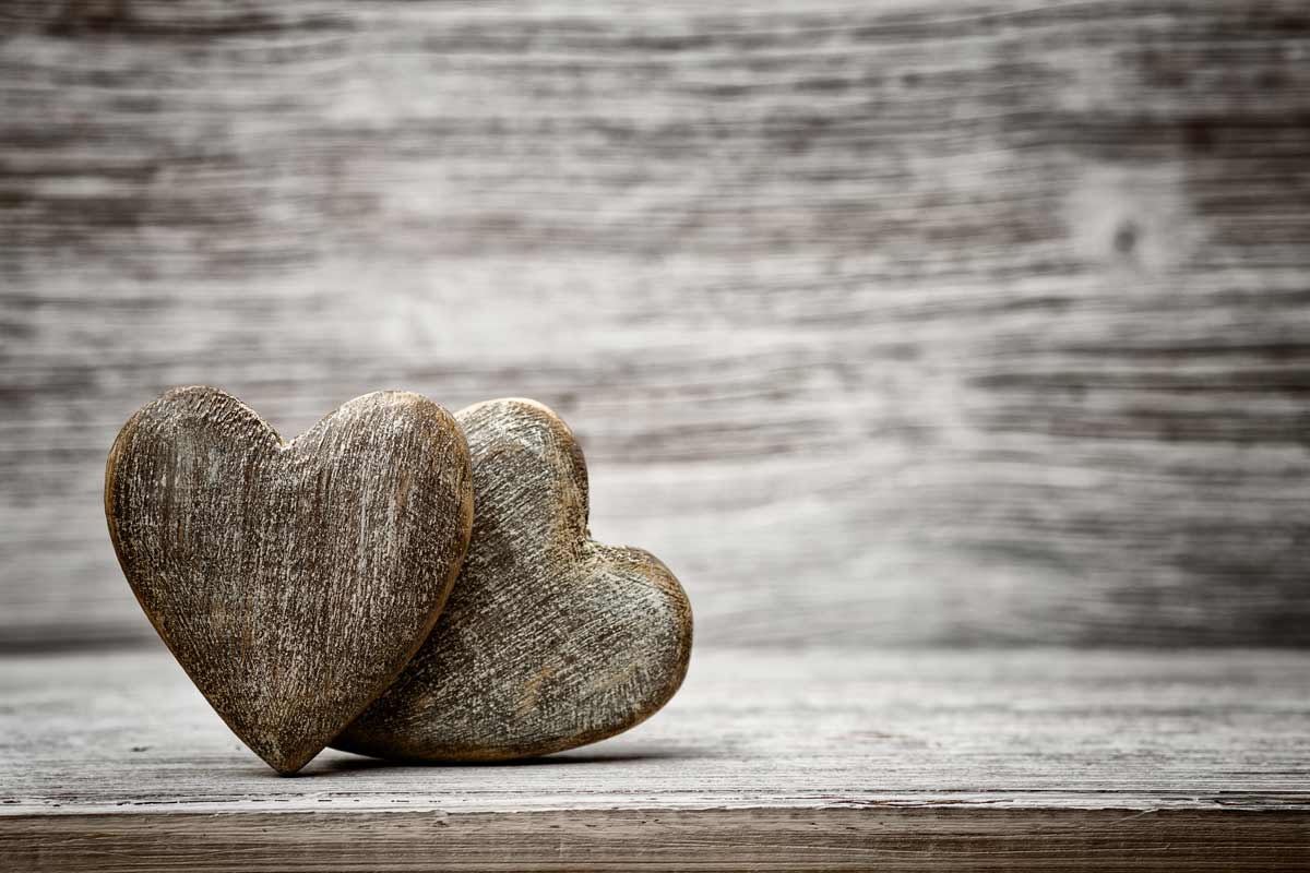 two wooden hearts on a wooden bench vintage look